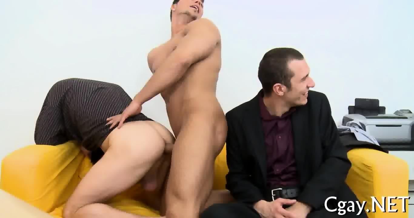 Bisexuals having erotic pleasure on couch