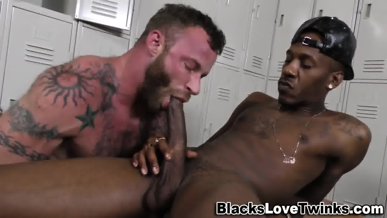 Bear sucks black cock