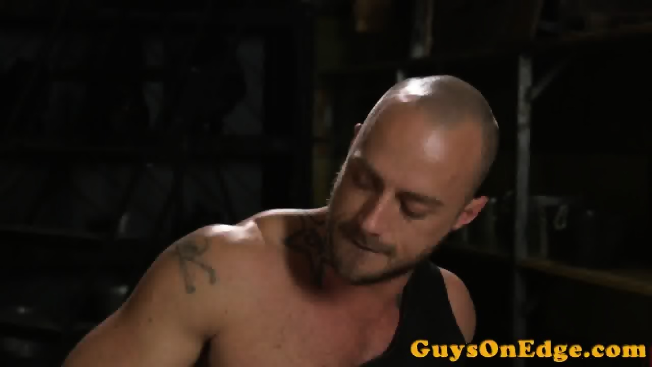 Tattooed dom edging restrained subs cock