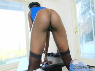 Black stripper in uniform twerking