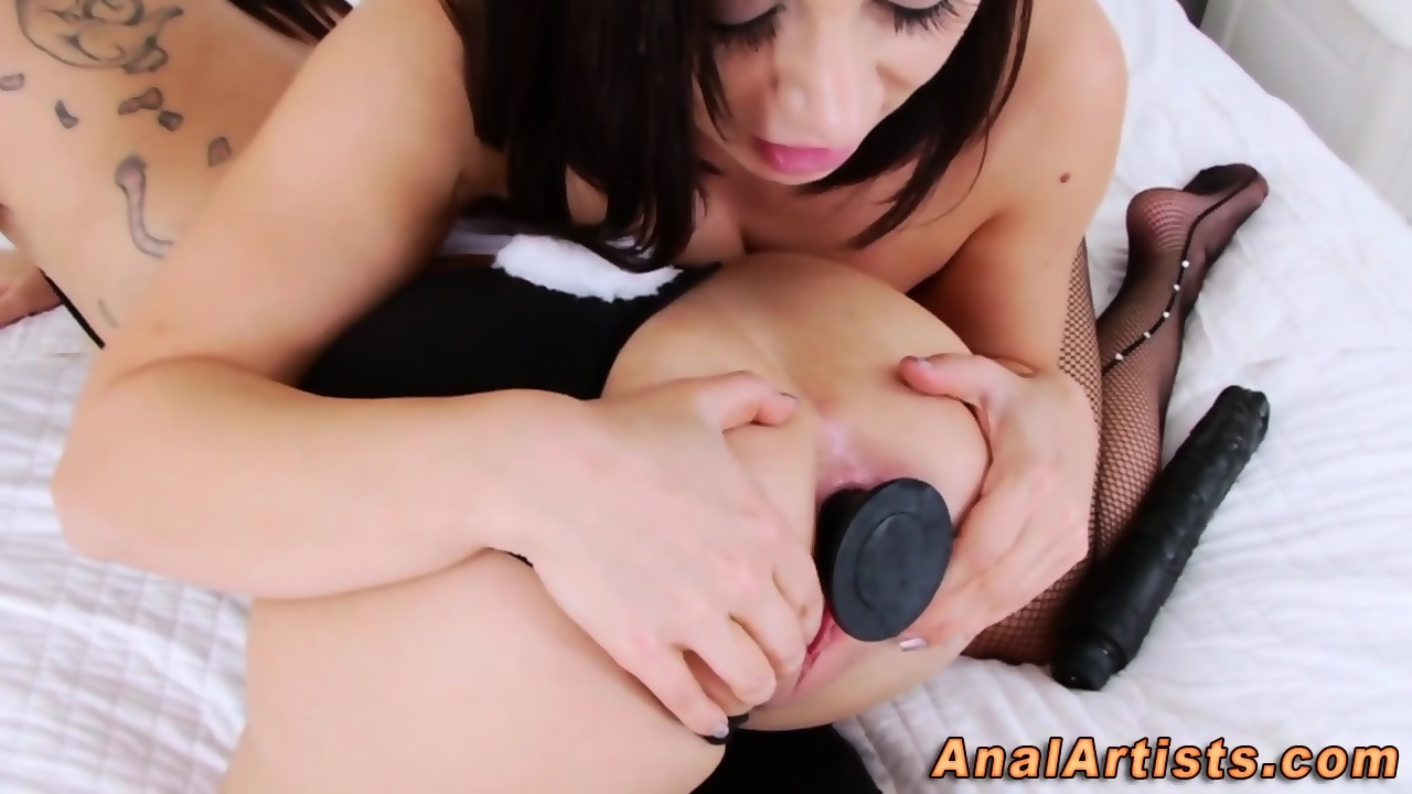 Anally toying lesbian