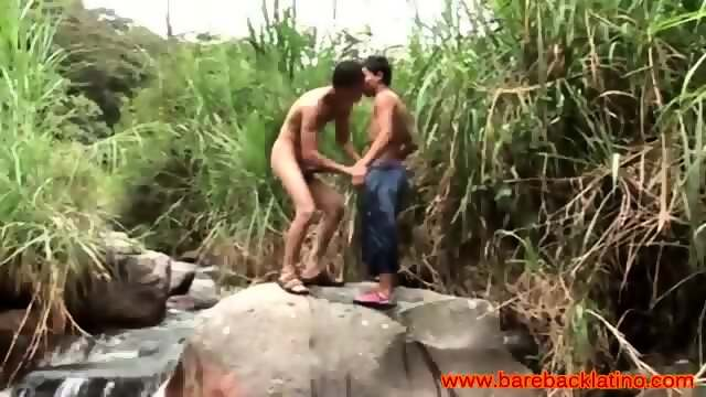 Latin twinks in river sucking each other