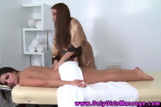 Hot masseuse rubs pussy