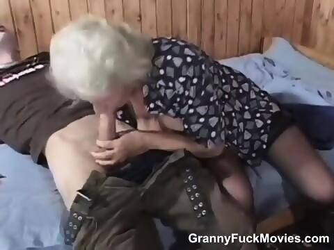 Horny granny sucks cock