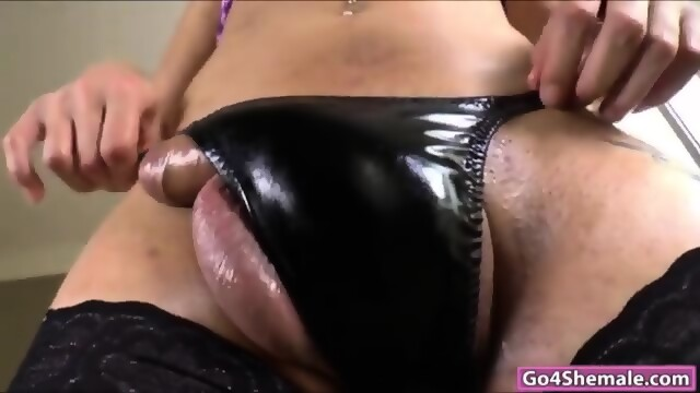 Big tit shemale Danielly Colucci jerking off her cock for cum