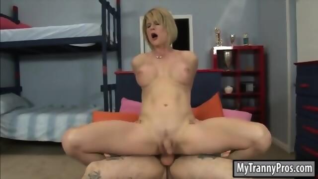 Busty blonde tranny delia delions strokes cock and rides