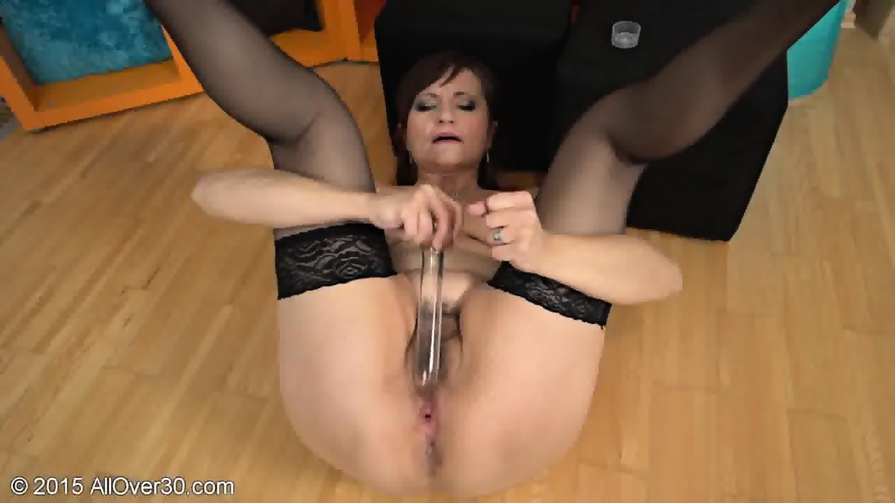 Mature woman playing with herself