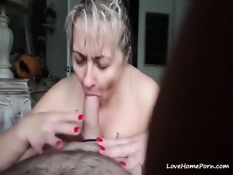Mature wife on knees sucks for cum