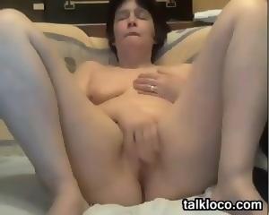 Granny rubs pussy