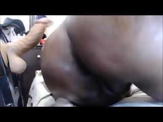 Ebony with mounted dildo